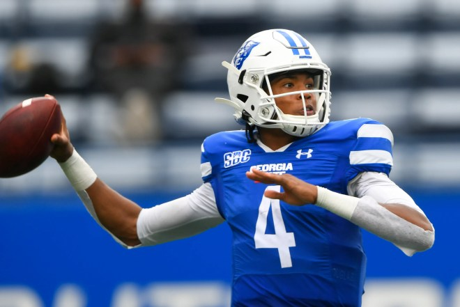 Georgia State quarterback Cornelious Brown IV (4) passed for 2,278 yards and 17 touchdowns a year ago. JOHN AMIS/AP