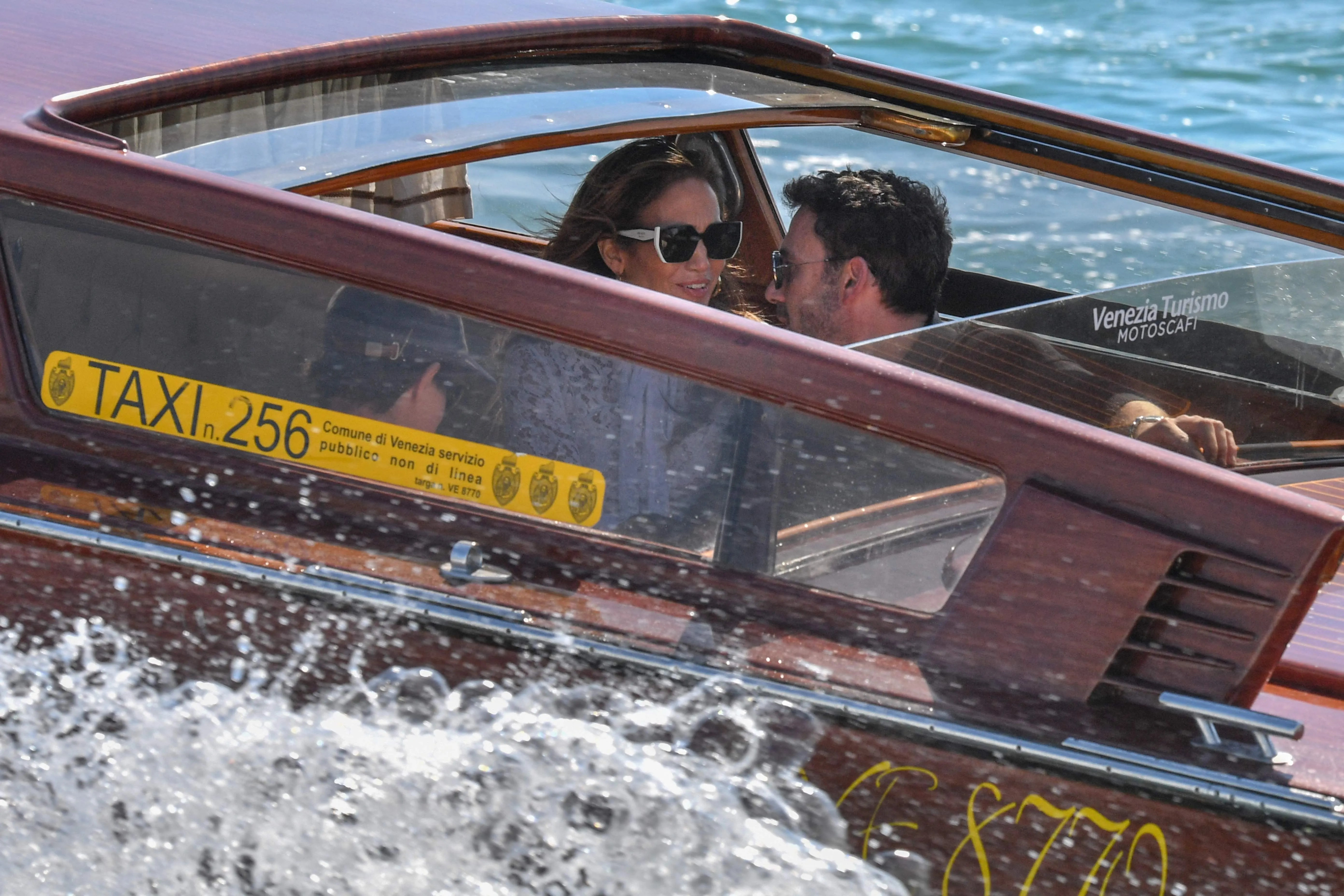 Ben Affleck and Jennifer Lopez travel across the Venice basin towards the Cipriani Hotel aboard a vaporetto taxi boat on Sept. 9, 2021 after they arrived to attend the 78th Venice Film Festival in Venice.