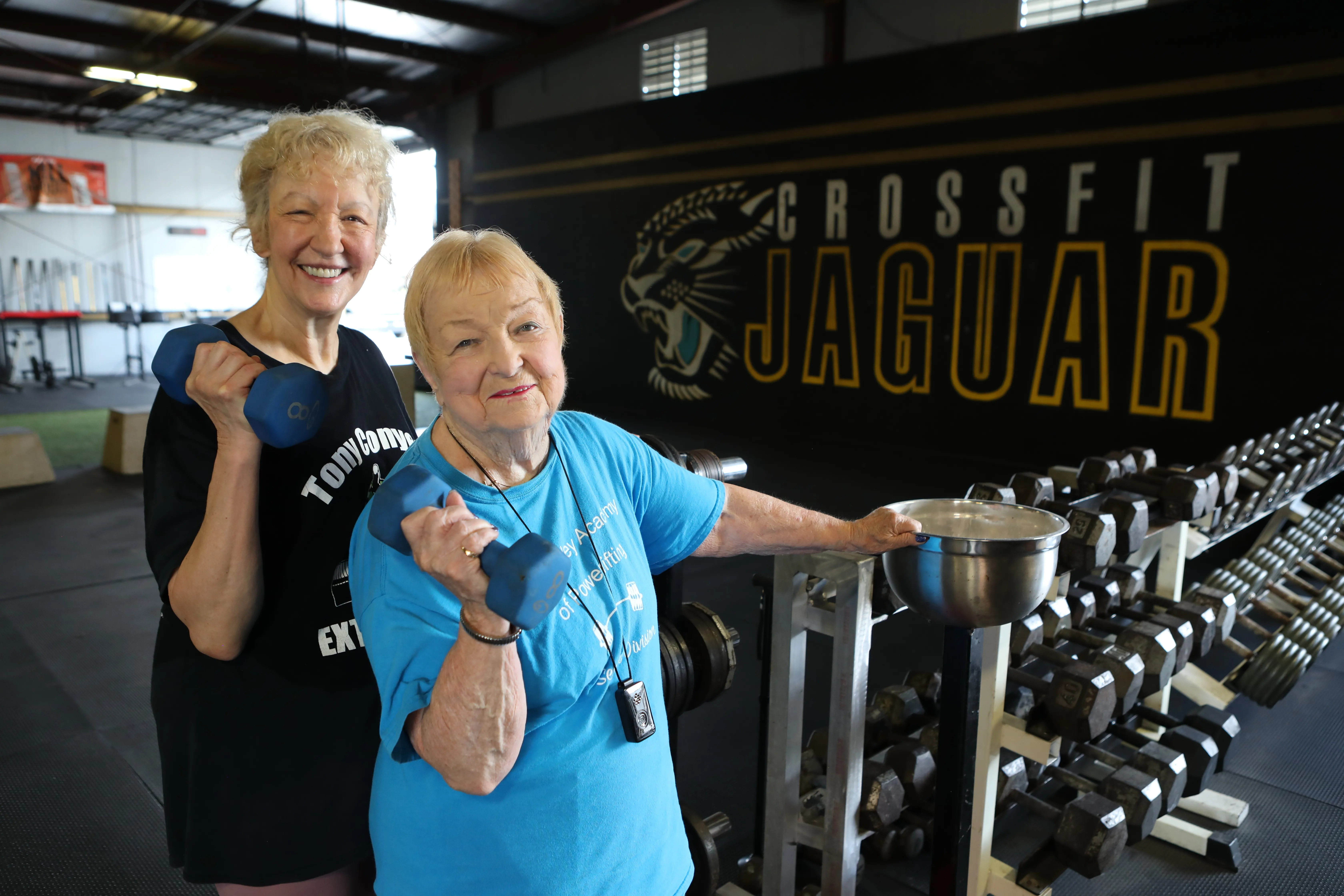 Edith Murway-Traina, 100, shown here with her friend Carmen Gutwirth (left) will feature in the upcoming Guinness World Records 2022 after winning the title of oldest competitive powerlifter (female).