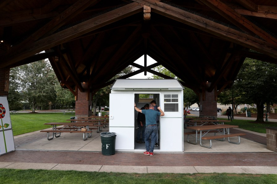 People see prefabricated transitional housing for homeless or unprotected people at a pallet truck sponsorship event in Salem, Ore.  Friday, September 17, 2021. Both units cost $ 5000 to sponsor.