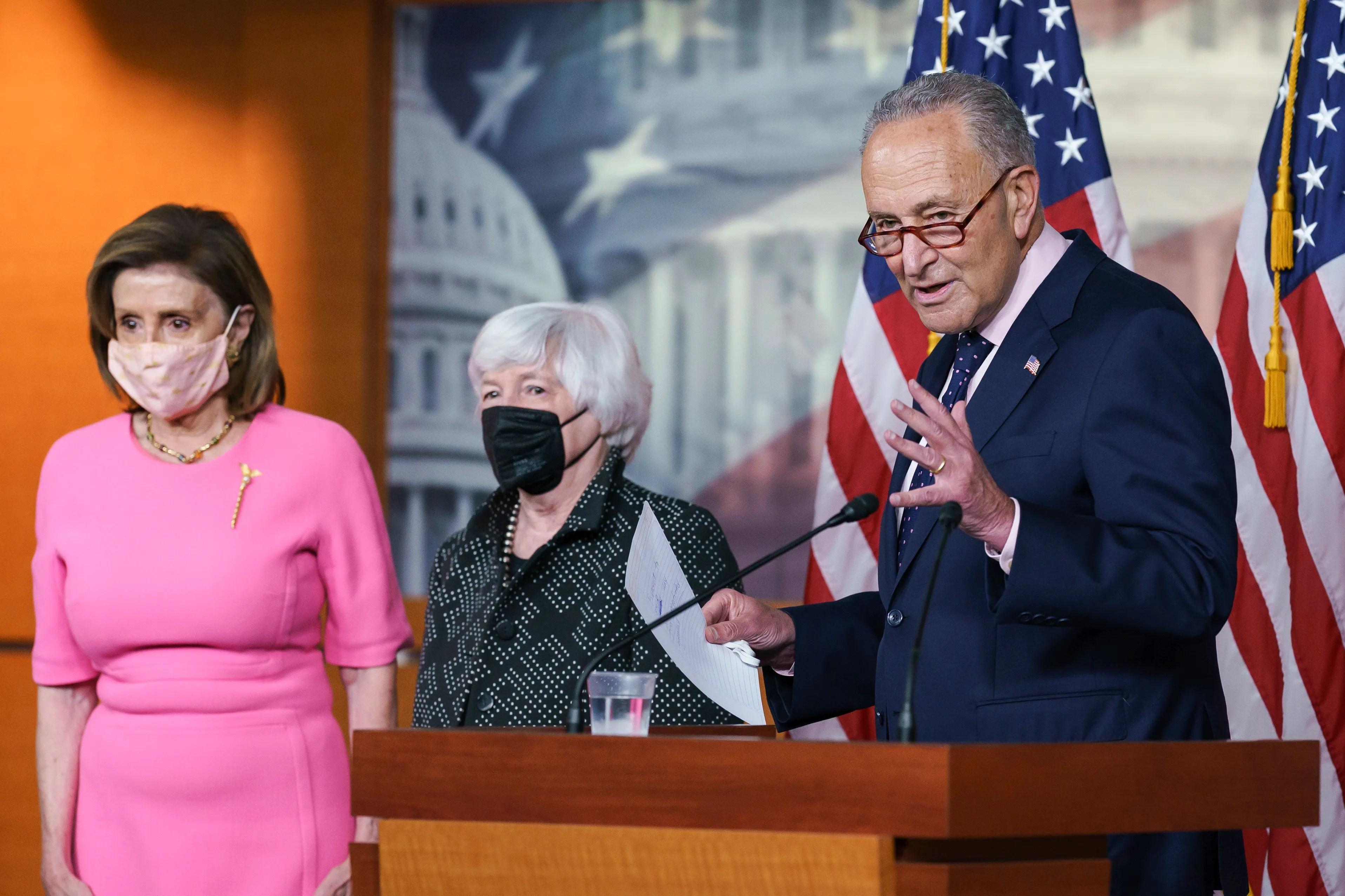 "House Speaker Nancy Pelosi, D-Calif., Treasury Secretary Janet Yellen, center, and Senate Majority Leader Chuck Schumer, DN.Y., brief reporters on Democratic efforts to pass the President Joe Biden ""Rebuild better"" agenda at the Capitol in Washington on September 23."