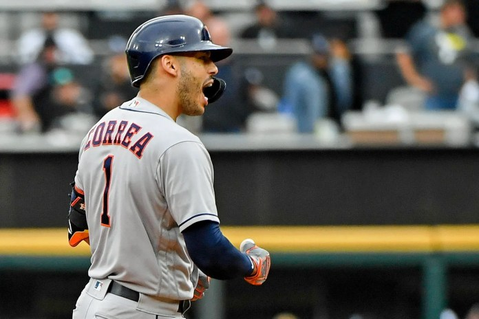 ALDS Game 4: Carlos Correa reacts after hitting a two-run double in the third inning.