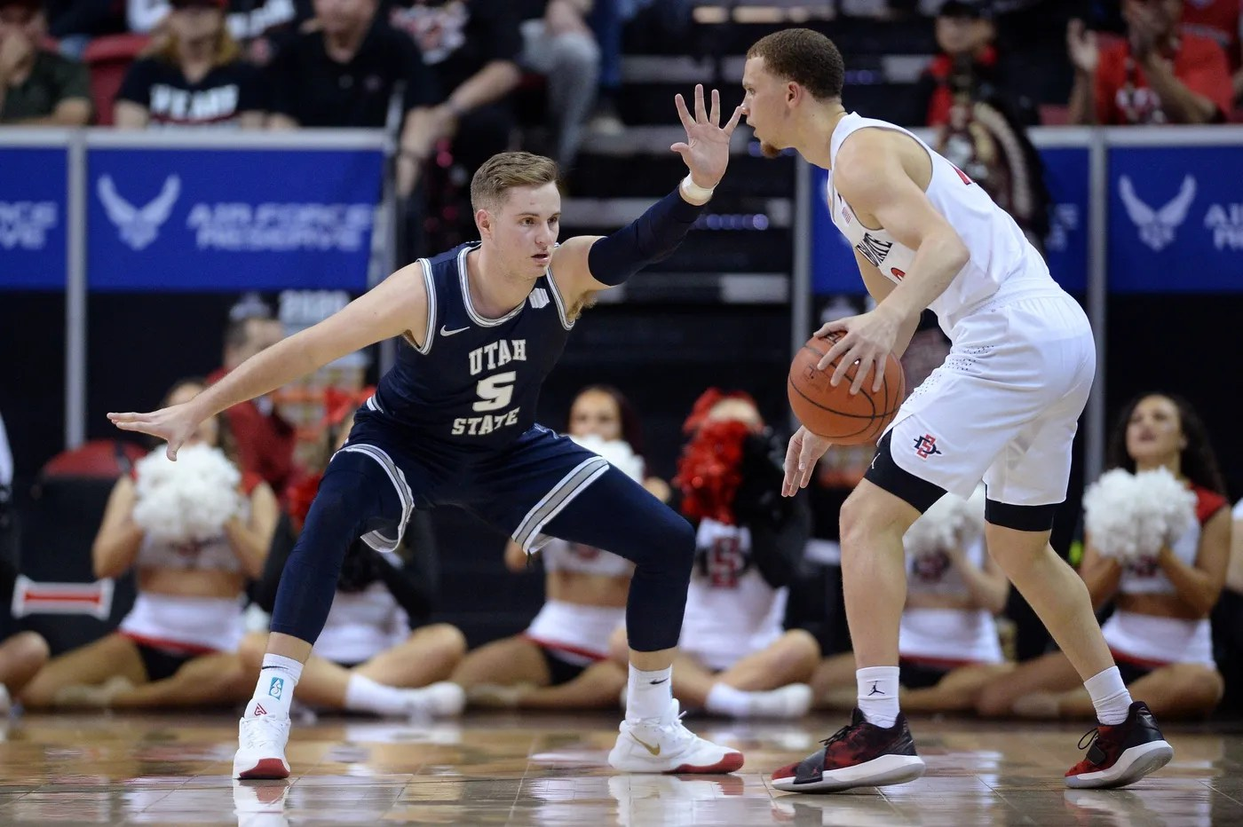 Mar 7, 2020; Las Vegas, Nevada, USA; Utah State Aggies guard Sam Merrill (5) defends San Diego State Aztecs guard Malachi Flynn (22) during the second half of the Mountain West Conference tournament final at Thomas and Mack Center.