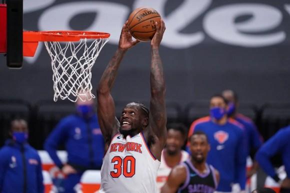 Jan 22, 2021; Sacramento, California, USA; New York Knicks forward Julius Randle (30) dunks the ball against the Sacramento Kings in the second quarter at the Golden 1 Center.