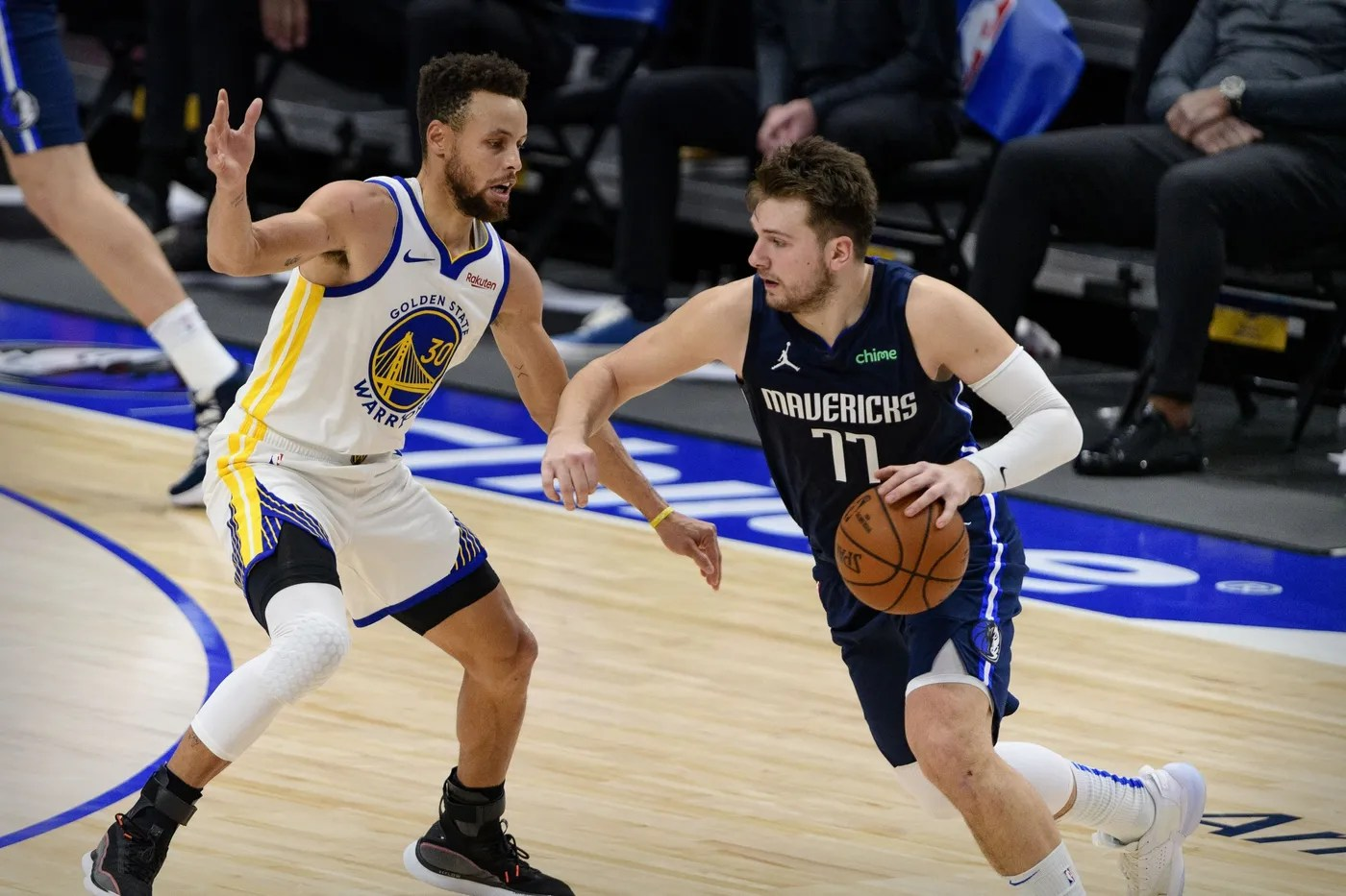 Feb 6, 2021; Dallas, Texas, USA; Golden State Warriors guard Stephen Curry (30) and Dallas Mavericks guard Luka Doncic (77) in action during the game between the Dallas Mavericks and the Golden State Warriors at the American Airlines Center.