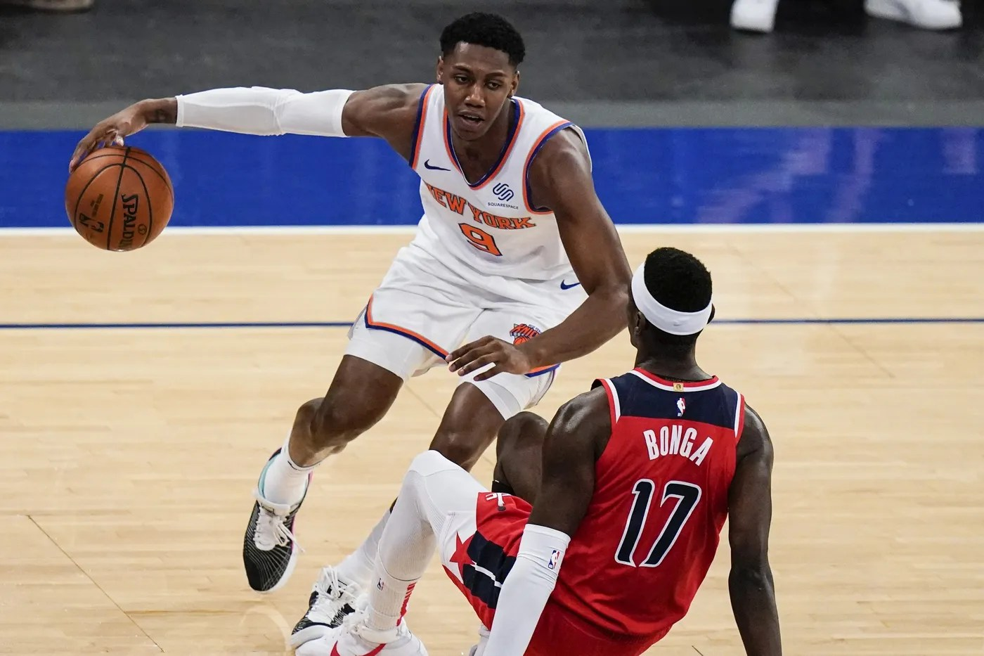 Mar 25, 2021; New York, New York, USA; Washington Wizards' Isaac Bonga (17) defends New York Knicks' RJ Barrett (9) during the second half of an NBA basketball game at Madison Square Garden. Mandatory Credit: Frank Franklin II/POOL PHOTOS-USA TODAY Sports
