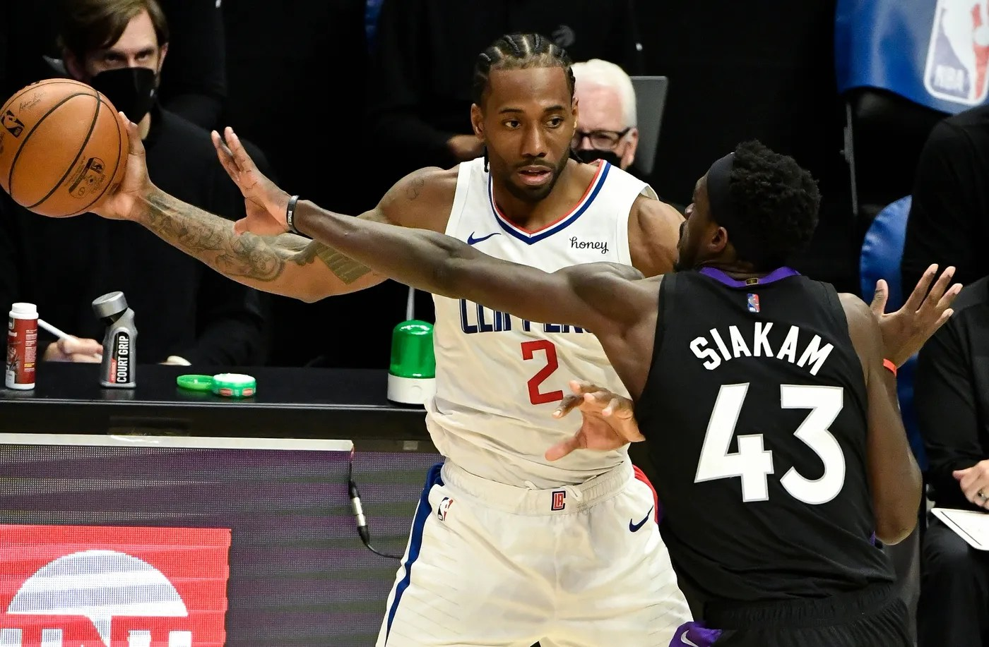 May 4, 2021; Los Angeles, California, USA; LA Clippers forward Kawhi Leonard (2) is defendedd by Toronto Raptors forward Pascal Siakam (43) during the third quarter at Staples Center.