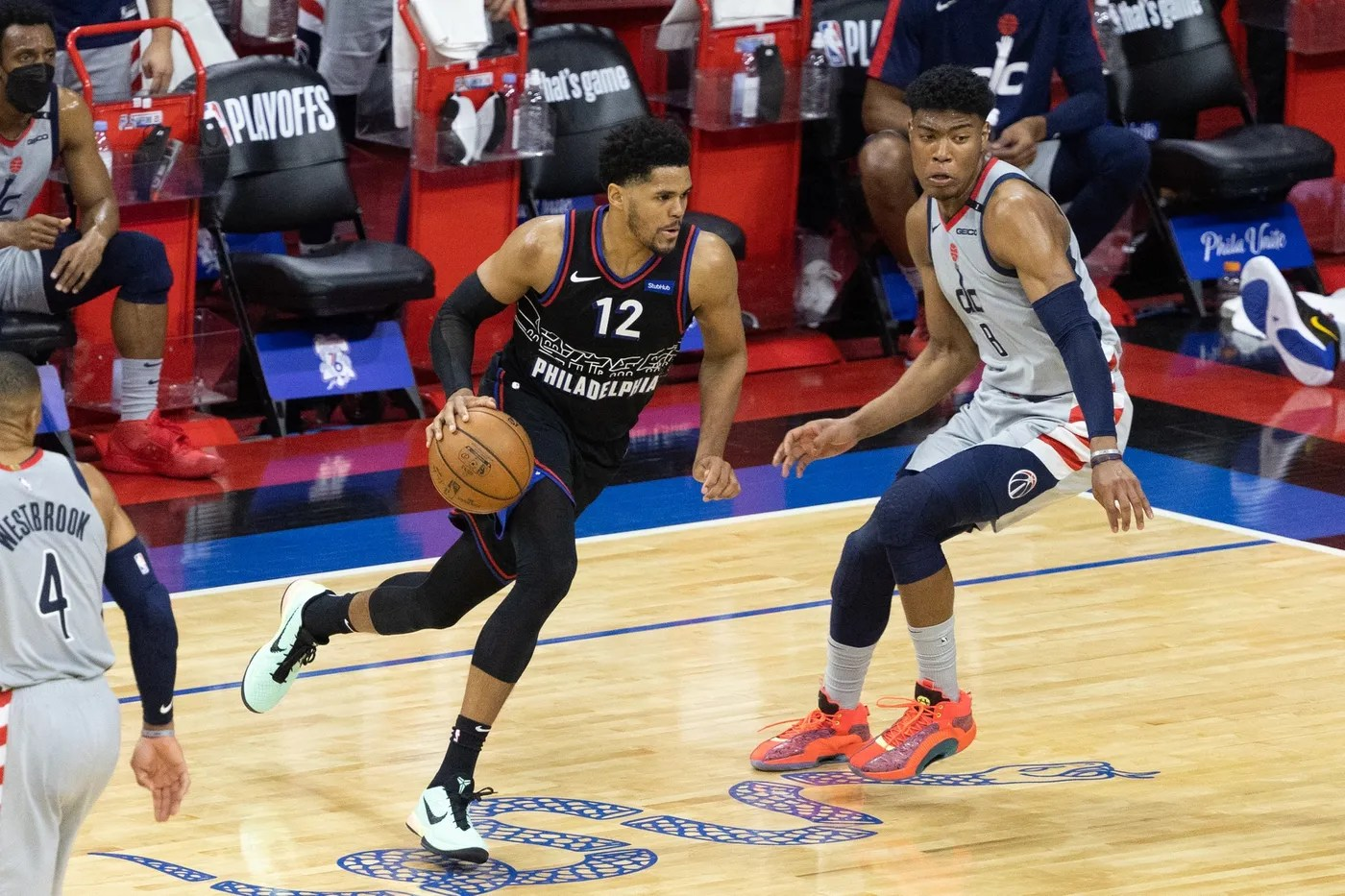 May 23, 2021; Philadelphia, Pennsylvania, USA; Philadelphia 76ers forward Tobias Harris (12) dribbles against Washington Wizards forward Rui Hachimura (8) during the fourth quarter of game one in the first round of the 2021 NBA Playoffs at Wells Fargo Center.