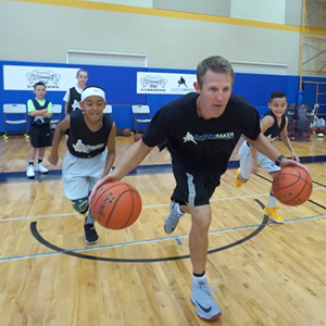 Ganon Baker doing basketball drills with kids during Live Training