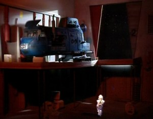 A blurry Cat in Blue Midget's hangar