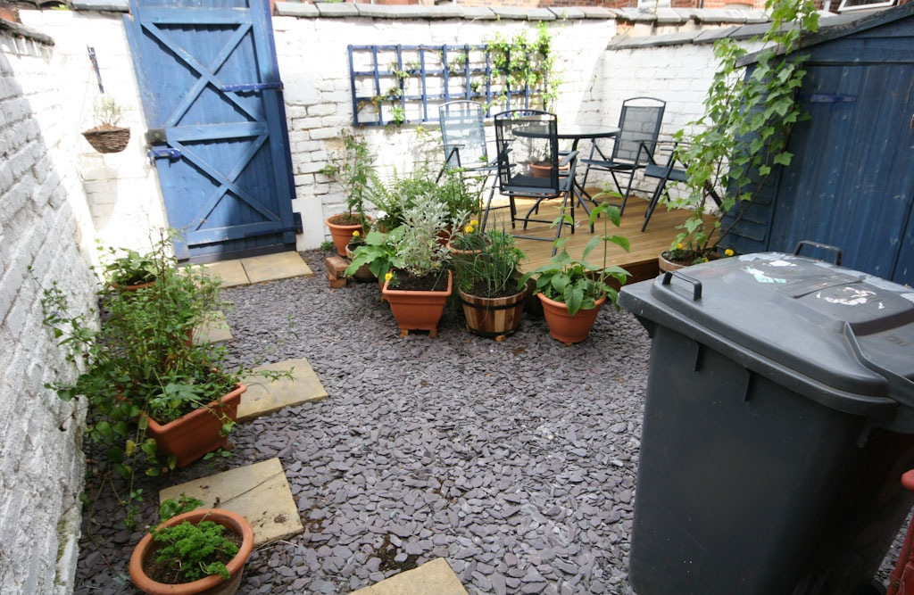 Turning a concrete terraced yard into a garden ... on Terraced House Backyard Ideas id=58978