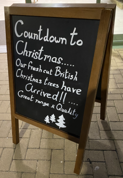 Effective use of A frame signage to announce the arrival of real Christmas trees at the entrance of the Garden Centre
