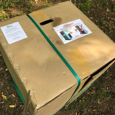 Large cardboard box containing the Aerobin Composter pieces