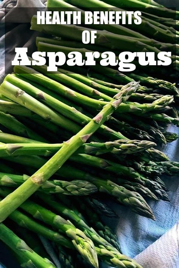 asparagus in kitchen with text overlay health benefits of asparagus