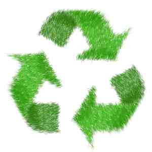 Green grass arrows forming the recycling symbol in a bid to fight the recycling war