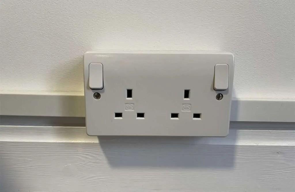Electrical sockets inside a garden office.