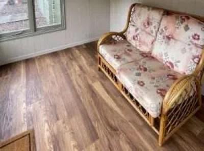 Vinyl or laminate floor in summerhouse.