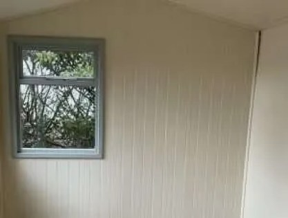 shiplap or tongue & groove shed interior wall.