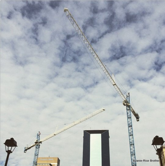 The  cranes do add a badly-needed sculptural air to the giant pit.