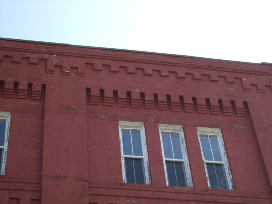 A detail of the corbelling on the National Oak Leather Company building.