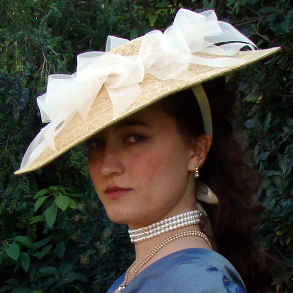photo reference of a woman outside with vintage style hat