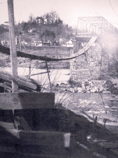 Temporary Falmouth Bridge, circa 1918. This image was taken from the Fredericksburg side of the river but a similar swinging bridge was built on the Falmouth side, as well, because an ice dam had carried off both ends and left only the middle section.