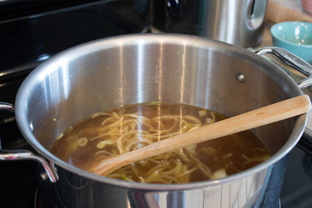 onions and broth for spicy vegan pho from the garlic hussy