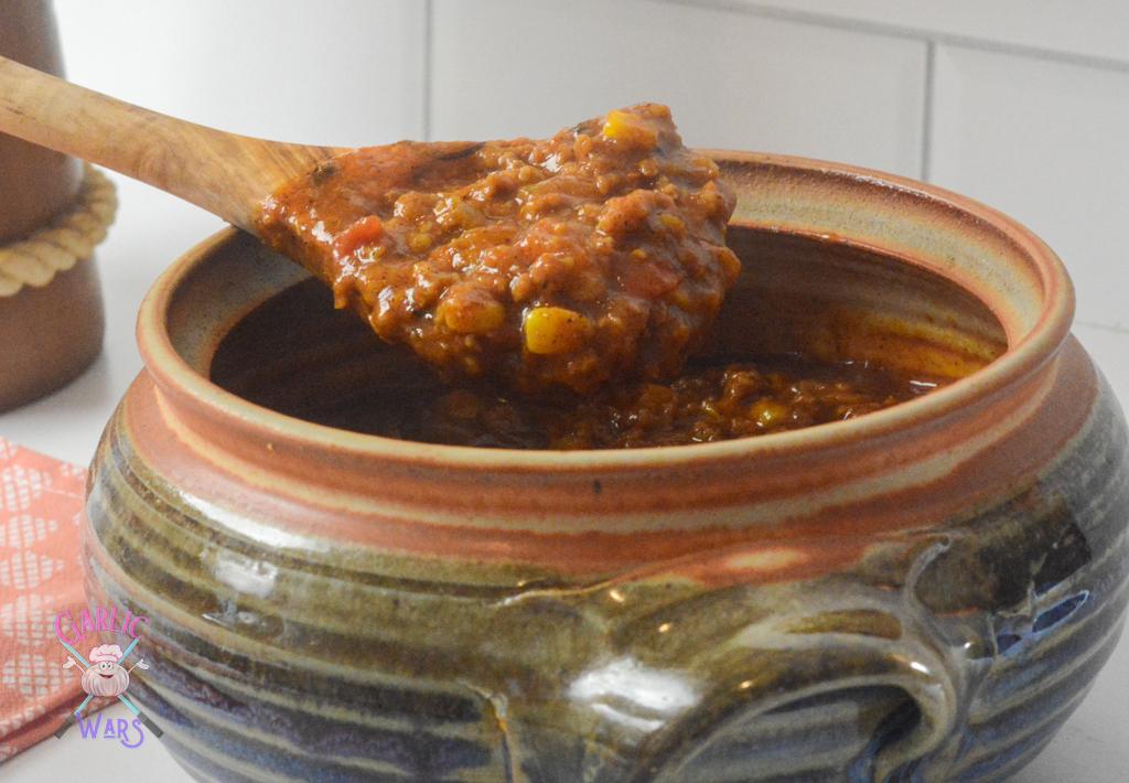 pumpkin chili on a big wooden spoon