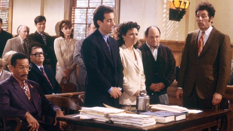 Jackie Chiles, Jerry, Elaine, George, and Kramer in a court room, awaiting their sentencing.