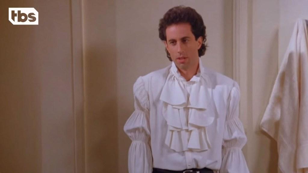 Jerry wears a puffy shirt.