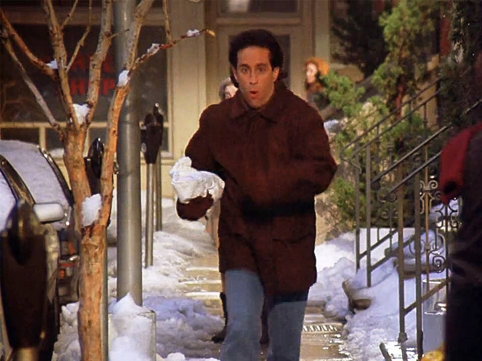 Jerry runs down the street with a marble rye in hand.