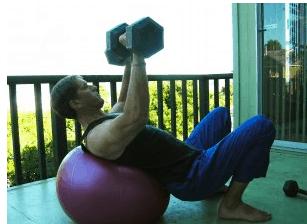 Joe Garma Dumbell presses on balance ball