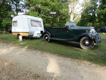Old fashioned car and caravan
