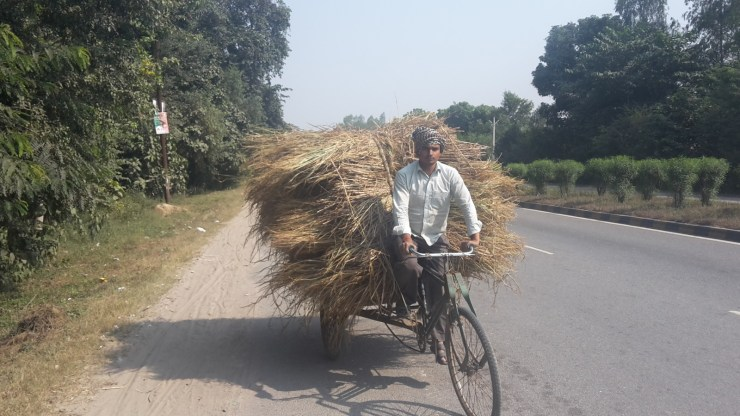 Indian man on a bike
