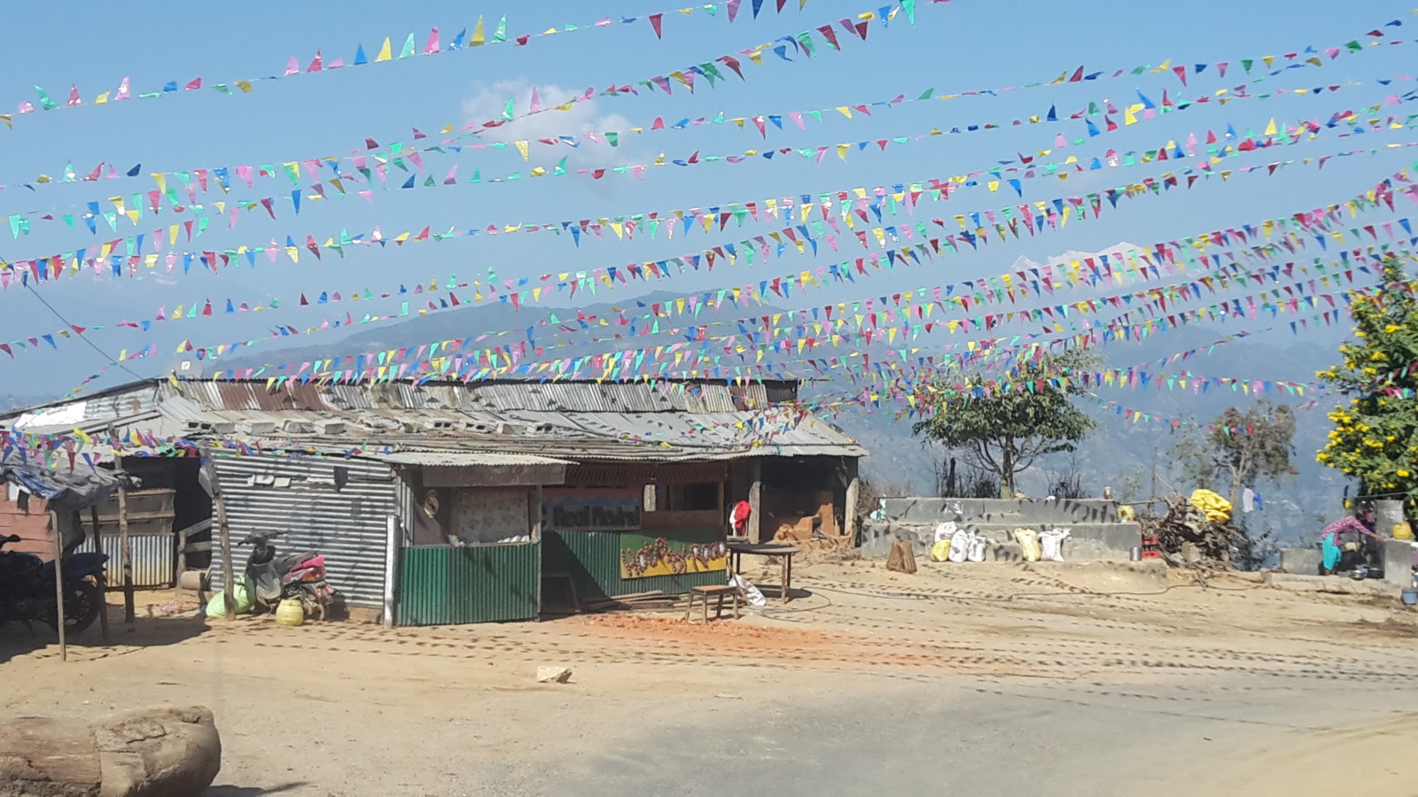 Flags at one of the villages on the Tribhuvan Highway.
