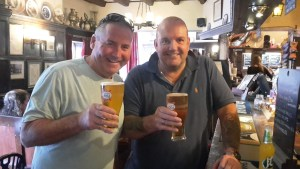 Two men having a drink