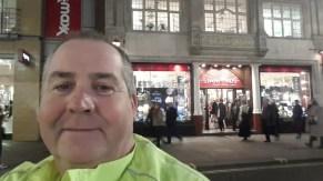 Man outside shop