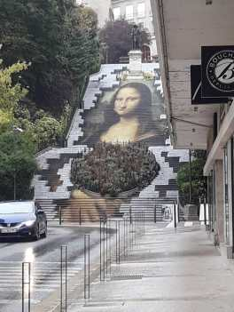 Giant Mona Lisa on the steps in Blois