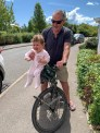 Man on bike with baby