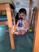 Baby holding a can