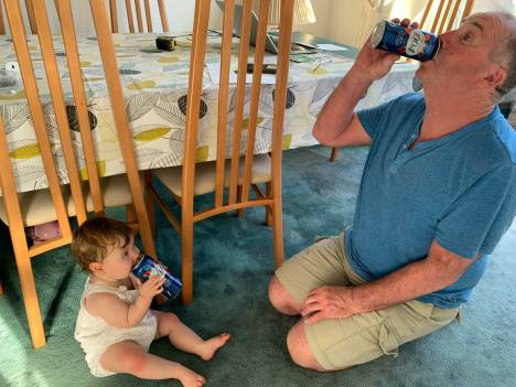 Man and baby drinking