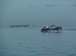 Hovercraft and ship on the sea