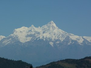 At the top of the Tribhuvan Highway at the Simbhanjyang Pass looking at the snow covered mountains in the distance