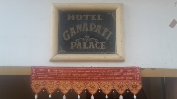 Sign outside the hotel Ganapati Palace in Dhule.