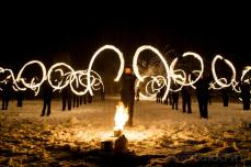 Fire performers spwinging fire poi form a spectacular part of the Imbolc Festival