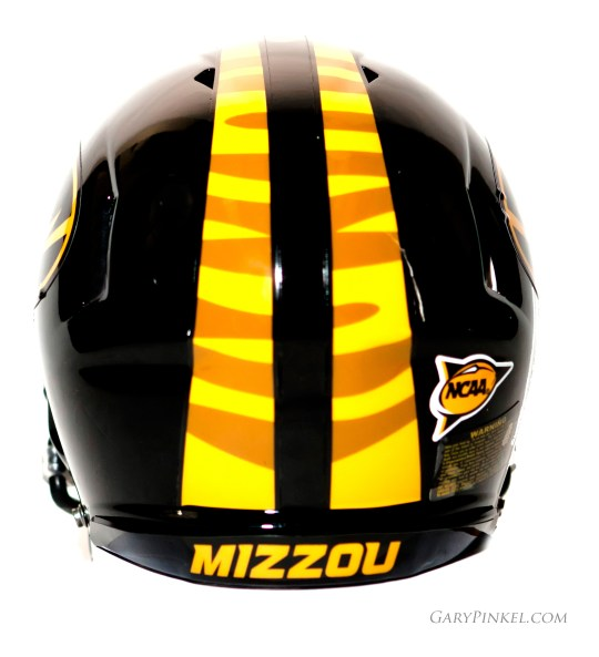 The traditional Mizzou Tiger football helmet says Mizzou on the back in special font designed by Nike.