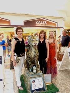 Artist Carolyn Wallace poses with Meg Ladd and Carol Mertensmeyer of ParentLink, Rah's charity partner.