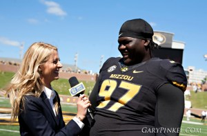 Defensive tackle Josh Augusta chats with an ESPN reporter about his first-half interception.