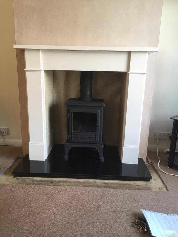 Brompton limestone mantel with Essence wood burning stove