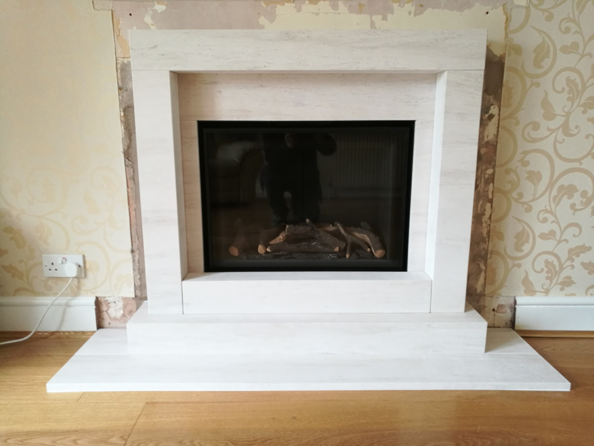 Ethos 750 with limestone fireplace